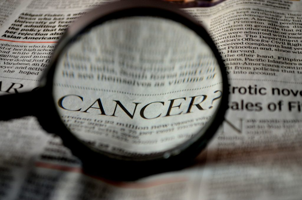 news - cancer - lung cancer - magnifying glass