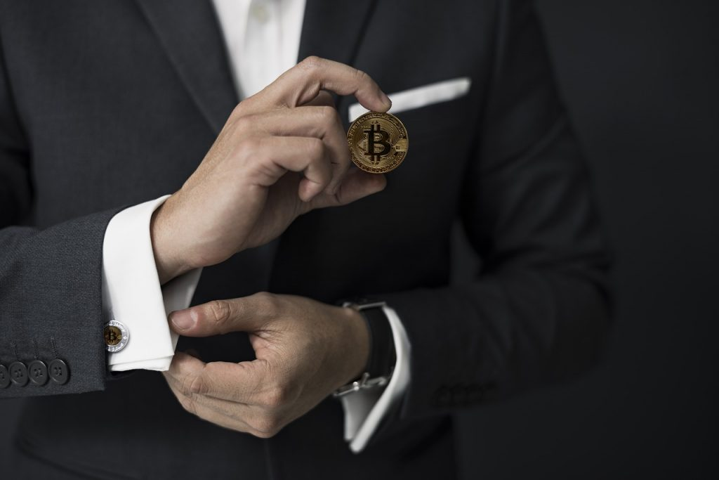 lawyer holding a bitcoin in his hand